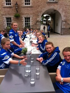 The girls having a bite to eat on the way to Derry before their 1st match